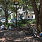 Homeless people gather at Five Points Park in downtown Sarasota. Herald-Tribune Staff photo / Dan Wagner